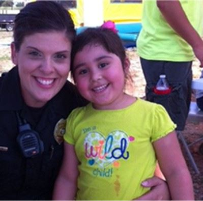 Cop with girl at event