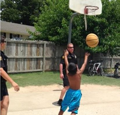 Police playing basketball with kids