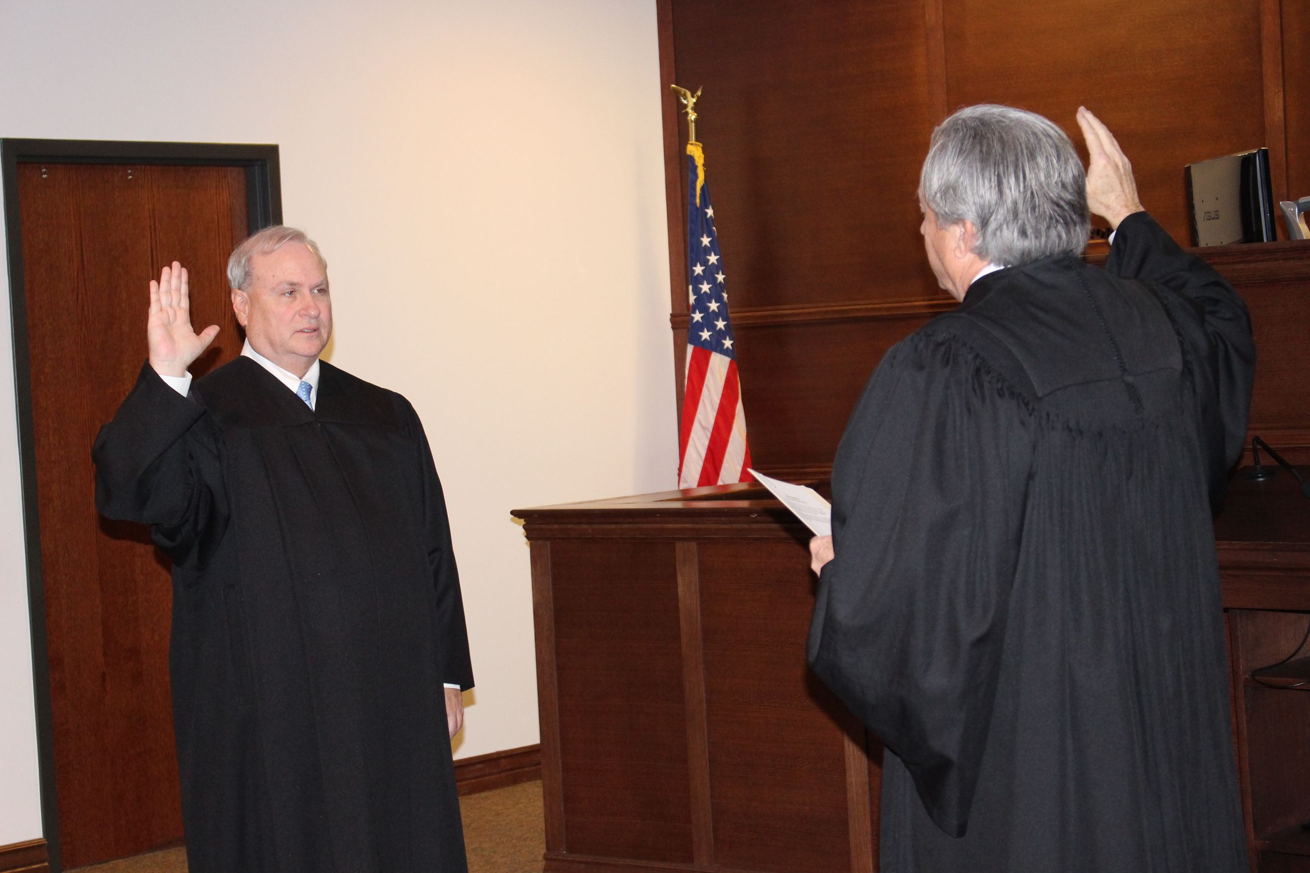 Judge Harper being sworn in by Judge Gladwin, 1-2-2017